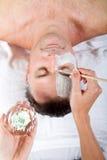 Man facial mask stock photography