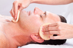 Man facial massage Stock Photo