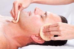 Man facial massage stock photo