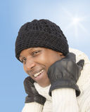 Man facing the cold during a sunny winter day Royalty Free Stock Photos