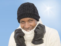 Man facing the cold during a sunny winter day Stock Image