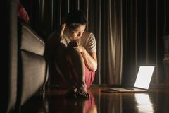 Man facing depression disorder sit on floor with laptop beside,. Conceptual image showing effect from social media resulting in depression disorder Stock Images
