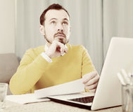 Man facing difficulty. Male student having problem during studying at online courses at home Stock Photography