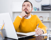 Man facing difficulty. Young male student having complicated issue at online courses at home Stock Image