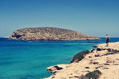 Man facing the Illa des Bosc island, in Ibiza, Spain Stock Photos