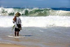 Man facing the sea copacabana beach Stock Photos