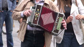 Man in a fair playing with vintage accordion stock footage