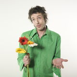 Man with fake flowers Royalty Free Stock Images