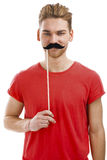 Man with a fake moustache Stock Photography