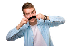 Man with fake mustaches. Isolated on white background royalty free stock photography