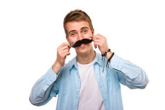 Man with fake mustaches. Isolated on white background stock photography
