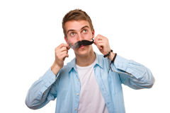 Man with fake mustaches. Isolated on white background stock images