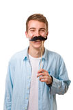 Man with fake mustaches. Isolated on white background royalty free stock photos