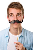 Man with fake mustaches. Isolated on white background stock photo