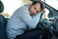 Man falling asleep in car after long hour drive Royalty Free Stock Photos