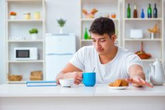 The man falling asleep during his breakfast after overtime work Stock Photos
