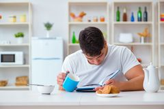 The man falling asleep during his breakfast after overtime work Royalty Free Stock Image