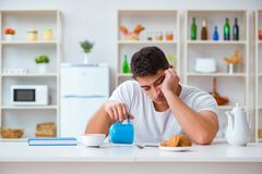 The man falling asleep during his breakfast after overtime work Stock Images