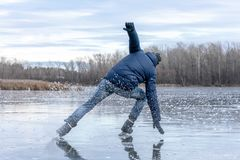 Man falling down while ice skating. Snow skates from the scatter in the parties royalty free stock image