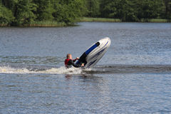 A man is falling down from jet ski. Royalty Free Stock Images