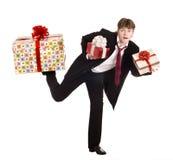 Man with falling gift box run. Stock Photography