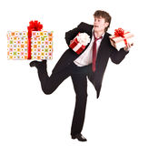 Man with falling gift box run. Stock Image