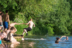 Man falling into River Avon after being pushed, with swimmers Royalty Free Stock Photography