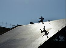 Man falling on skateboard. Silhouette of man falling on skateboard at Megarampa event in Rio de Janeiro Royalty Free Stock Image