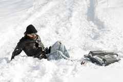 Man falling from a sledge after a sleigh ride in deep snow Stock Image