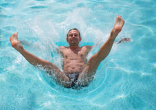 Man falling and splashing into water Stock Image