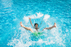 Man falling and splashing into water Stock Photos