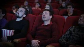 Man falls aspeep at cinema stock video