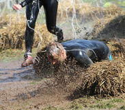 A man falls into the mud Royalty Free Stock Photography
