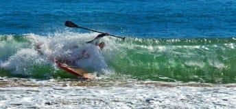 Man falls off paddleboard Royalty Free Stock Image