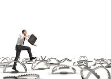 Man run in a thousand difficulties. Man falls into trap. Concept of difficulty in life and work Royalty Free Stock Photos