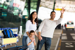 Man  family hailing taxi Stock Photo