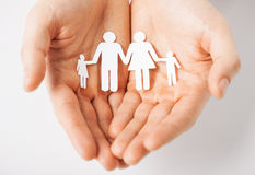 Man with family of paper men Stock Images