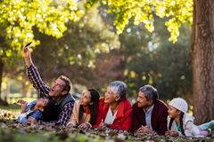 Man with family taking selfie at park Stock Photography