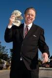 Man fanning himself with money. stock photos