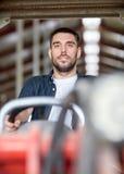 Man or farmer driving tractor at farm Stock Photos