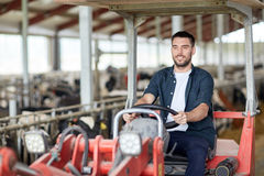 Man or farmer driving tractor at farm Royalty Free Stock Photography