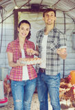 Man farmer and woman holding container with eggs Stock Photography