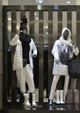 Man Fashion clothing shop window with mannequins in down coat, christmas decoration,dress store  window, shop decoration Royalty Free Stock Photo