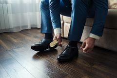 Man fashion, men`s Accessories,businessman clothes shoes, Politi. Cian, man`s style, Businessman buttoning his shirt,American, European businessman, People Royalty Free Stock Photography
