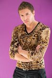 Man in a fashionable leopard t-shirt and black trousers. Portrait of a beautiful man in a fashionable leopard t-shirt and black trousers stock images