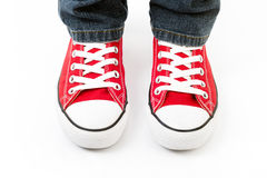 A man in a fashionable red Converse sneakers Stock Image