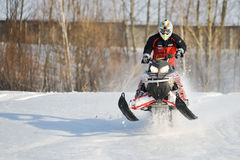 Man and fast action snowmobile jumping Royalty Free Stock Images