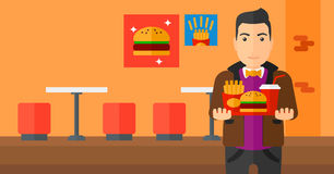 Man with fast food. Stock Image
