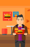 Man with fast food. Royalty Free Stock Photography