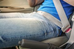 Man fasten seat belt while driving a car for safety on the road. Close up man fasten seat belt while driving a car for safety on the road stock photography